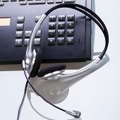foto of telemarketing  - office desk with telephone and headset objects break work - JPG