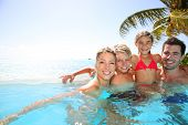 picture of infinity pool  - Happy family enjoying bath time in infinity pool - JPG