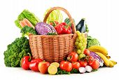 stock photo of vegetables  - Wicker basket with assorted organic vegetables and fruits isolated on white - JPG