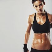 image of slim model  - Picture of a fitness model on grey background - JPG