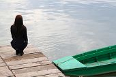 pic of promontory  - Young brunette girl waiting on a promontory - JPG