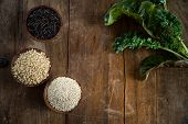 picture of quinoa  - Fun with food small wood bowls filled with brown rice quinoa and wild rice on the left kale and Swiss chard on the right - JPG