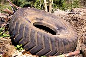 Used Obsolete Tractor Tire Lying On Pile Of Debris