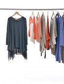image of vest  - female fashion clothing  and vest on hangers at the show - JPG