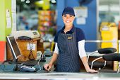 stock photo of cashiers  - beautiful woman working as a cashier at the supermarket - JPG