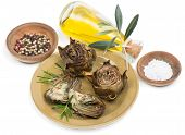 pic of artichoke hearts  - Grilled artichoke served with olive oil pepper and salt - JPG