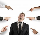 pic of strangle  - Concept of accused businessman with fingers pointing - JPG