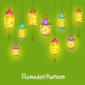 stock photo of muslim  - Illuminated hanging lanterns on green background for holy month of Muslim community Ramadan Kareem on green background - JPG