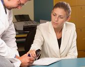 stock photo of medical doctors  - Medical secretary and doctor working together in the office - JPG