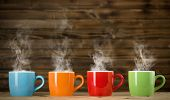 stock photo of breakfast  - cups with steaming drinkthe cups with steaming drink - JPG