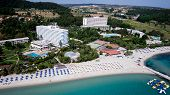 Top View Of Beach With Tourists, Sunbeds And Umbrellas At A Luxury Hotel. Sea Travel Destination. Ho poster