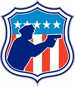 picture of policeman  - Illustration of a silhouette of a policeman police officer pointing shooting gun facing side set inside shield crest with american stars and stripes flag in the background done in retro style - JPG