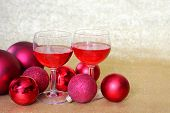 Постер, плакат: Two Wine Glasses Toast By Christmas Bulb Decorations