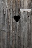 pic of outhouse  - old wooden door with a heart cut out  - JPG
