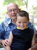 foto of senior-citizen  - Grandson with grandfather