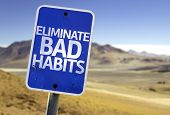 picture of  habits  - Eliminate Bad Habits sign with a desert background - JPG
