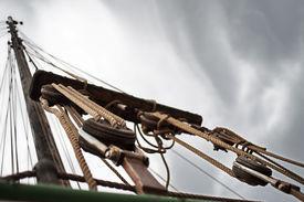 foto of sloop  - Stormy sky above the mast - JPG
