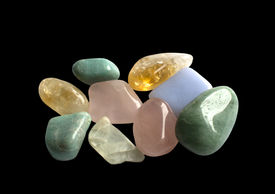 picture of calcite  - Semiprecious gemstones in yellow green and pink isolated on black - JPG