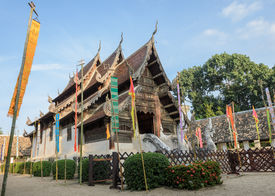 pic of woodcarving  - Ancient wooden teak temple of Lanna architecture with fine woodcarvings and gilded stuccos - JPG