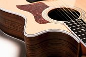 stock photo of bluegrass  - Closeup of a guitar on a white background - JPG