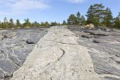 pic of gneiss  - Cliffs by the sea shaped by the heavy ice sheet during the last Ice Age - JPG