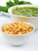 image of pesto sauce  - Pesto sauce with basil and pine nuts isolated on white - JPG