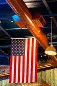 picture of copper  - An American flag hanging from ceiling with copper ductwork - JPG