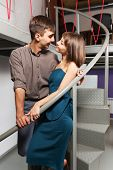 stock photo of office romance  - Young couple flirting in office - JPG