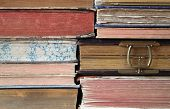 pic of bookworm  - Close up of a stack of hardback books - JPG