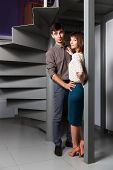 picture of office romance  - Young couple flirting in office - JPG