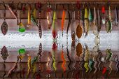 pic of hook  - Reflection different fishing hooks in the water - JPG