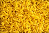 picture of allergy  - Full frame food background of colorful yellow spiral gluten - JPG
