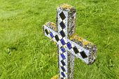 stock photo of empty tomb  - An old cross grave marker in rural Iceland - JPG