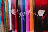foto of hmong  - Colorful silk scarfs in the Thai white ethnicity village of Mai Chau in Vietnam - JPG