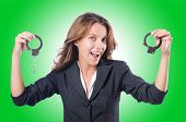 stock photo of white collar crime  - Female businesswoman with handcuffs on white - JPG
