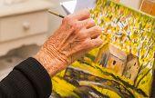 picture of senior class  - Senior woman painting - JPG
