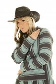 image of cowgirls  - A cowgirl in her poncho and western hat looking to the side - JPG