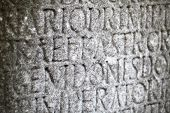 stock photo of chisel  - ancient Greek writing chiseled on stone texture - JPG