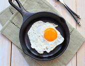 stock photo of breakfast  - Breakfast the fried egg in a iron frying pan - JPG