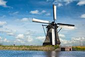 pic of windmills  - Traditional dutch windmill near the canal in the Netherlands - JPG