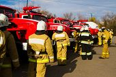 stock photo of fire truck  - Firefighters in protective clothing about fire trucks - JPG