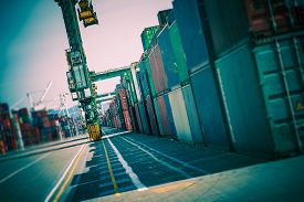 picture of shipyard  - Cargo Containers Alley. Shipping Containers Lot. Shipping and Logistic Theme. ** Note: Shallow depth of field - JPG
