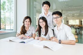 picture of classroom  - Group of asian students in uniform studying together at classroom - JPG