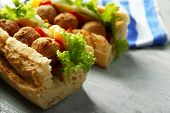 pic of meatball  - Homemade Spicy Meatball Sub Sandwich on wooden table background - JPG