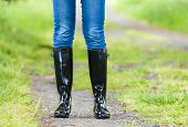stock photo of woman boots  - detail of standing woman wearing rubber boots - JPG
