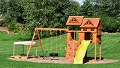stock photo of swingset  - Back Yard Wooden Swing Set on Green Lawn - JPG