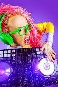 pic of dreadlock  - Expressive modern DJ girl wearing bright clothes - JPG