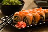 picture of soy sauce  - Sushi and chuka seaweed salad with soy sauce on wooden table - JPG