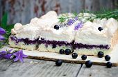 stock photo of sponge-cake  - Sponge cake with blueberries on an old wooden table - JPG