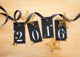pic of ribbon decoration  - 2016 written on gift tags with glittery christmas decoration - JPG